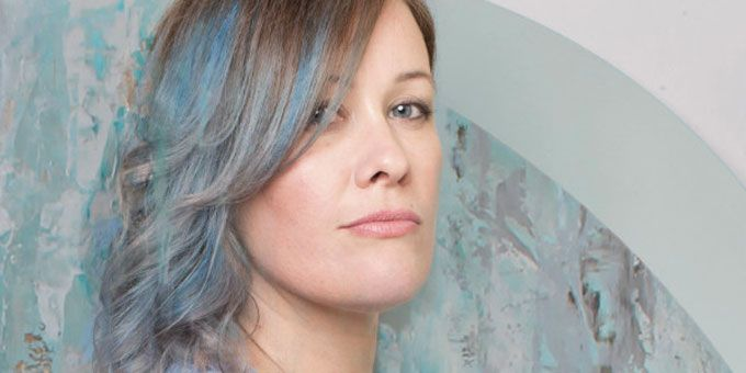 Woman with pastel blue hair