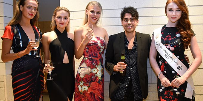 Benjamin Ringuet poses with models and guests at event on James St