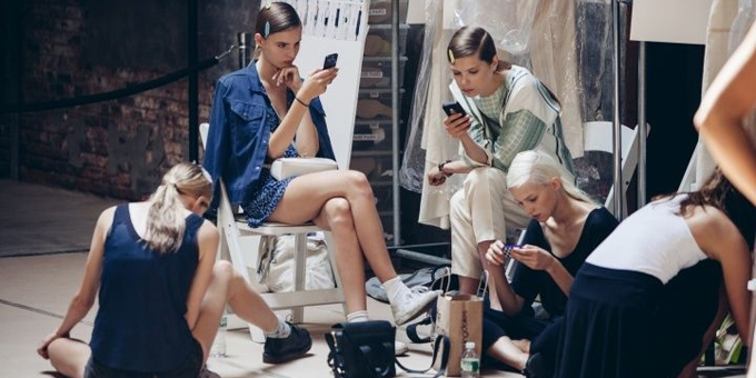 Fashion models on phone