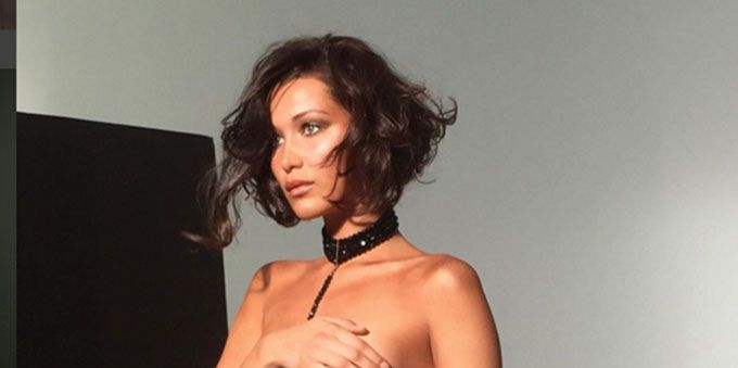Bella Hadid poses near nude in this sexy Instagram photo while saying sorry to her mother.