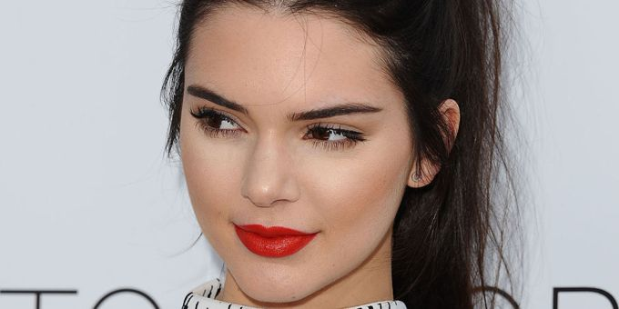 Kendall Jenner smiling red lipstick