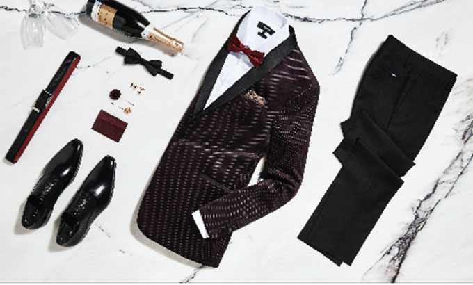 Velvet tux jackets and luxe suit accessories make a big statement for mens wedding attire.
