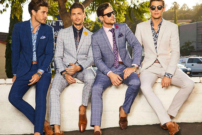 Checked suits and light tailoring make a cool impact for mens wedding suits.