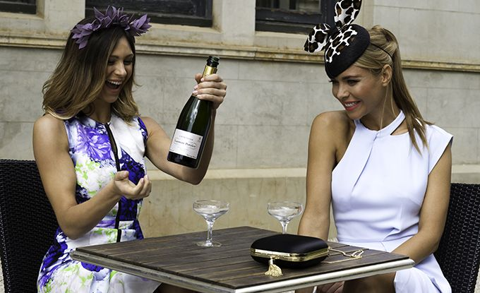 Models pose with champagne for online boutique Her Wardrobe