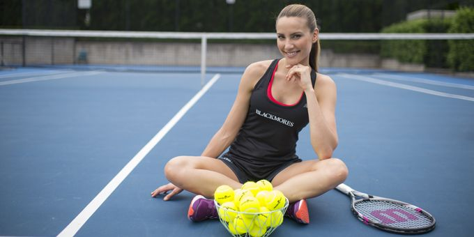 Rachel Finch wears Blackmores top and plays tennis