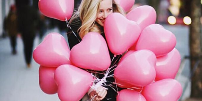 Girl with pink balloons for Valentines day