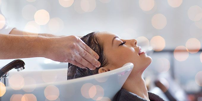 Queensland's best hair salon girl getting hair washed at basin