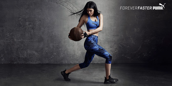 Kylie Jenner sporty with basketball
