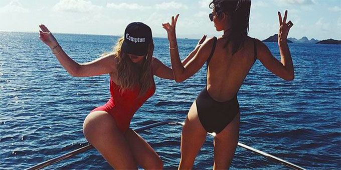 Kardashian sisters on boat body contoured with tan